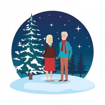 Grandparents couple with winter clothes in snowscape