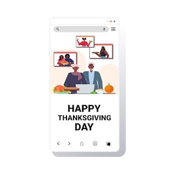 Grandparents discussing with children during video call celebrating happy thanksgiving day