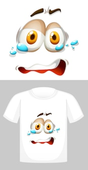 Disegno grafico su t-shirt bianca con faccina piangente