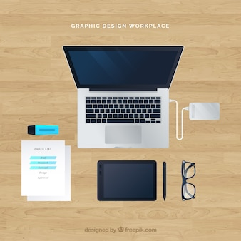Graphic design workplace background with top view