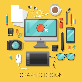 Graphic design workplace with computer and digital tools.