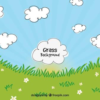 装飾的な雲と草の背景