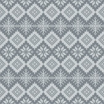 Gray knitted seamless pattern with snowflakes and traditional scandinavian ornament.