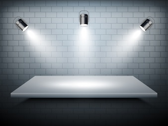 Gray shelf with spotlights on the wall