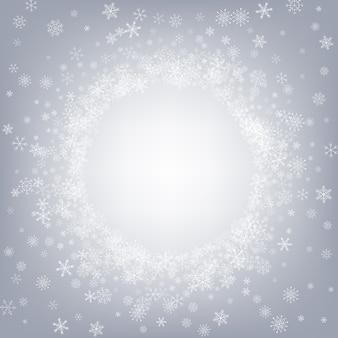 灰色の雪灰色の背景。ファンタジー降雪デザイン。ホワイトホリデー壁紙。冬のスノーフレークホリデー。