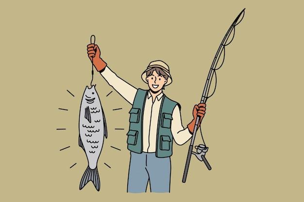 Отличный улов во время рыбалки. молодой улыбающийся человек мультипликационный персонаж, стоящий с огромной рыбой во время рыбалки, чувствуя себя счастливым позитивным вектором