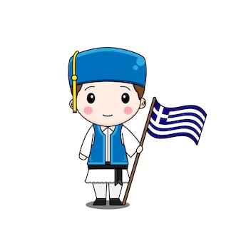 旗と民族衣装のギリシャの少年