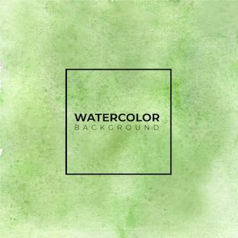 Зеленый абстрактный фон акварелью. это нарисованная рука