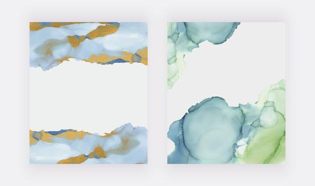 골드 반짝이 질감 배경으로 녹색 및 파랑 알코올 잉크 수채화.