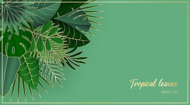 緑の背景に緑と金の熱帯の葉