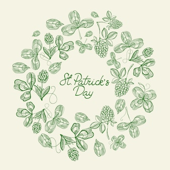 Stについてのテキストの周りに多くの伝統的な要素を持つ緑と白の円フレームスケッチ構成カード。パトリックの日