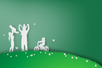 Green background happy family having fun playing in the field
