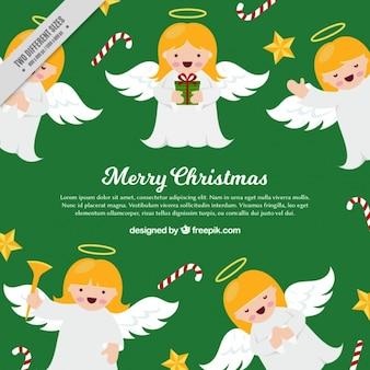 かわいいクリスマスの天使の緑色の背景