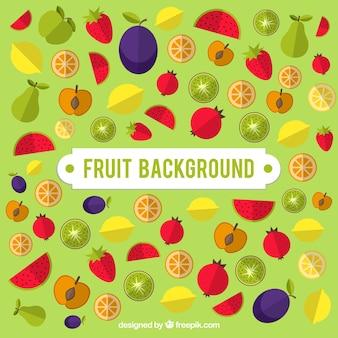 Зеленый фон с цветными фруктами