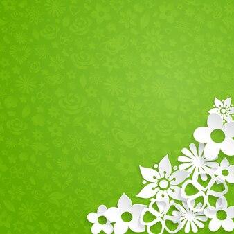白い紙から切り取った花と緑の背景