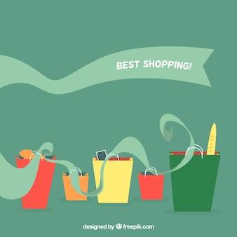 Sfondo verde con le borse della spesa