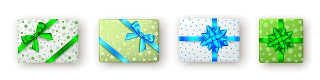 리본과 활 탑 뷰 크리스마스 새해 패키지 디자인이 있는 녹색 파란색 선물 상자