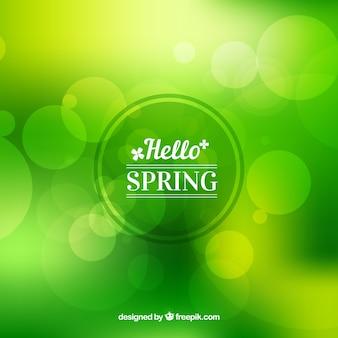 Green blurred background hello spring