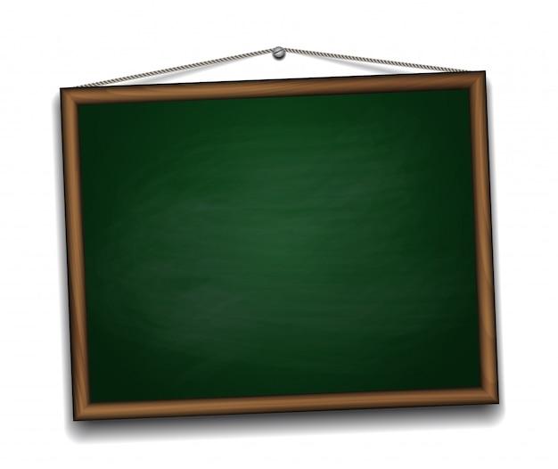 木製フレームの緑の黒板。学校の背景に戻る