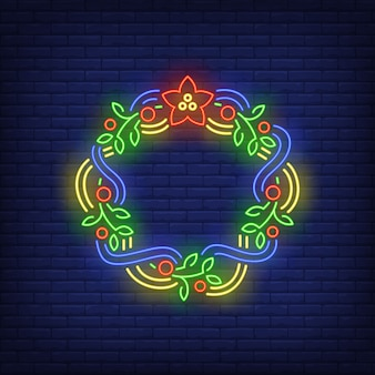 Green christmas wreath with blue and yellow ribbons in neon style