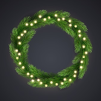 Green christmas wreath with incandescent light string and pine tree branches.