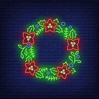 Green christmas wreath with red flowers in neon style