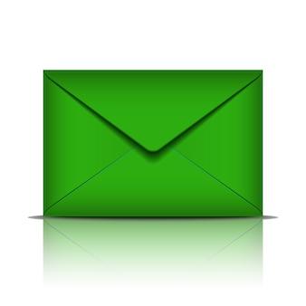 白い背景の上の緑の封筒。図
