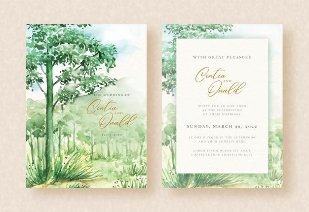 結婚式の招待状のテンプレートに緑の森と山の水彩風景の背景
