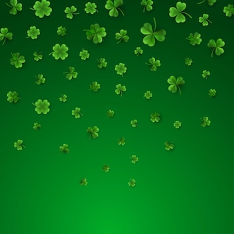 Green four and tree leaf clovers isolated on green