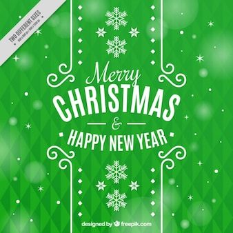 Green geometric background with snowflakes and bokeh effect