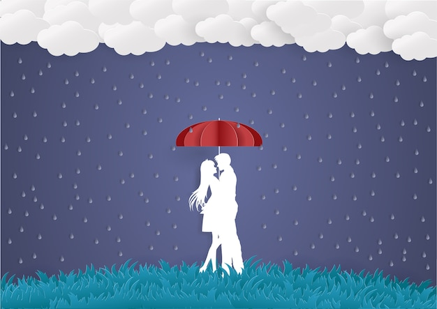 Green grass, rain and young man hug his lover with one red umbrella