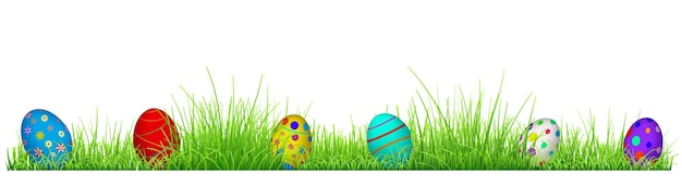 Green grass with easter eggs isolated on white background
