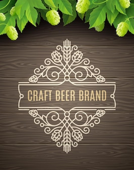 Green hops and flourishes beer emblem on a wooden plank background