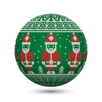 Зеленый вязаный рождественский бал на белом фоне с санта-клаусом и северным орнаментом. идеально подходит для поздравительных открыток или веб-баннеров.