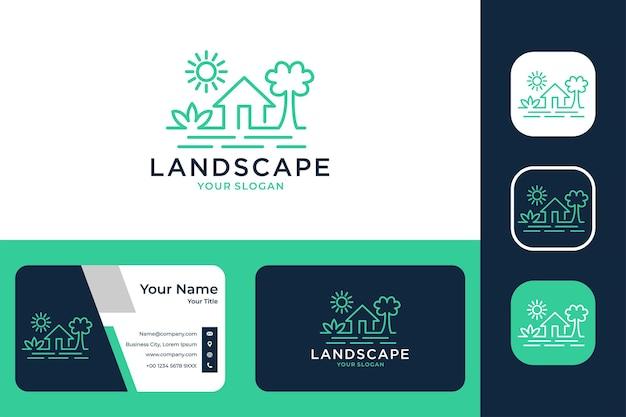 木のロゴデザインと名刺と緑の風景の家