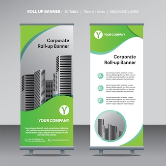 Green roll up banner design template with city background