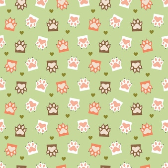 Green seamless pattern with cat paws and hearts