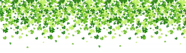 Green shamrocks falling background