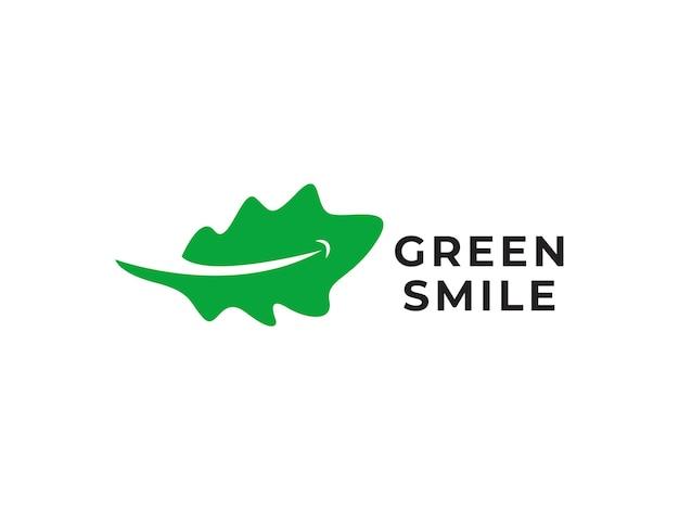 緑の笑顔のロゴのデザインコンセプト