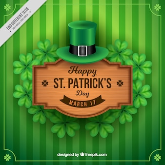 Green striped background with wooden sign of saint patrick's day