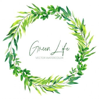 The green watercolor leaves and branches wreath