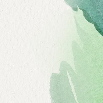 ベージュの背景に緑の水彩