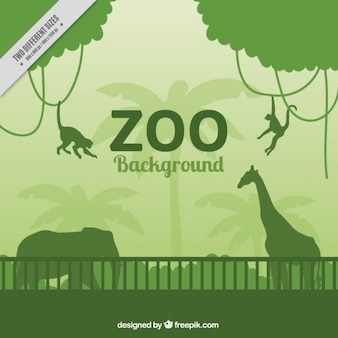 Green wild animals silhouettes in the zoo background