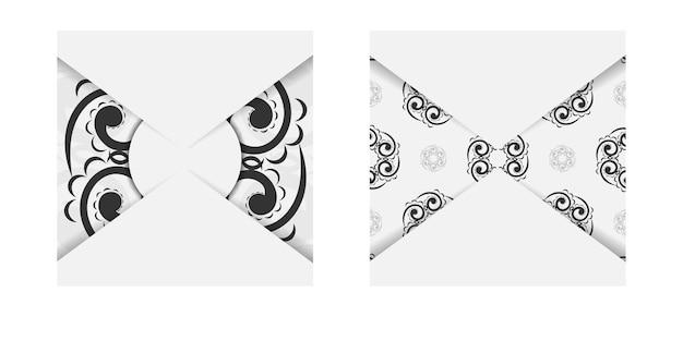 黒のギリシャの装飾が施された白の挨拶パンフレット