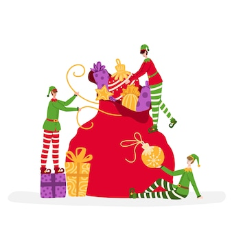 Greeting card christmas miniature elves are packing large gift bag