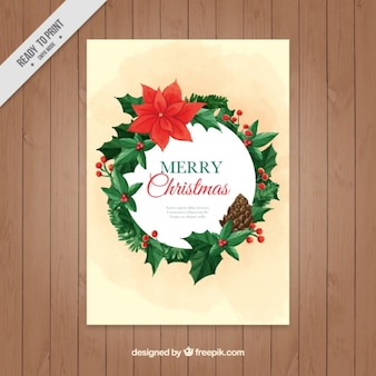 Greeting card for christmas with a floral wreath