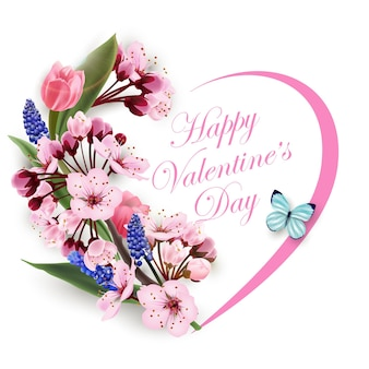 Greeting card happy valentines day with a heart of flowers pink tulips cherry blossoms