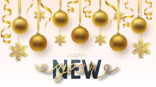 グリーティングカード、新年あけましておめでとうございますとクリスマスの招待状。メタリックゴールドとスノーフレークのクリスマスボール