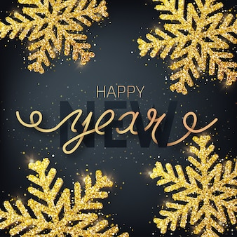 Greeting card, invitation with happy new year. hand written lettering on a black background. glitter covered gold snowflake.