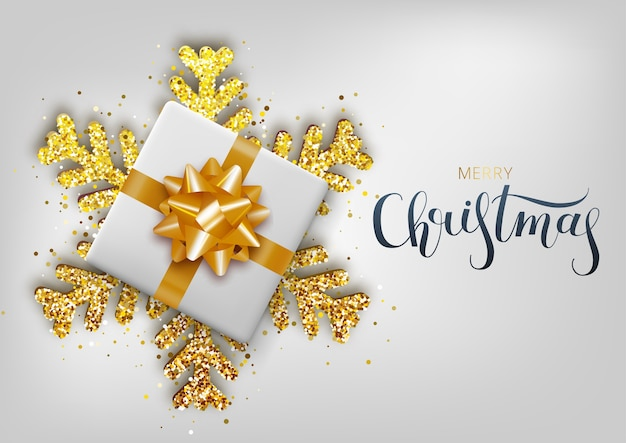 Greeting card, invitation with happy new year. hand written lettering. metallic gold christmas snowflake and gift box on a white background.